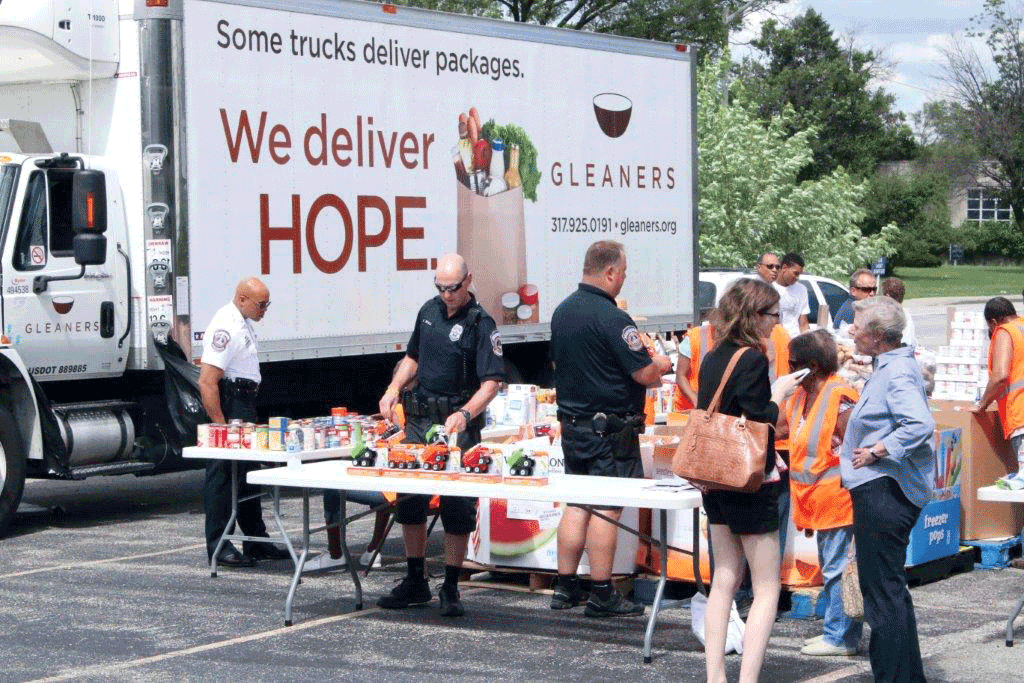 Gleaners and IMPD partner for 2nd summer food pantry