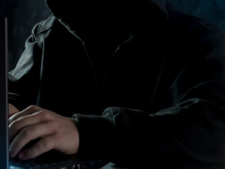 stock art of mysterious person at a computer