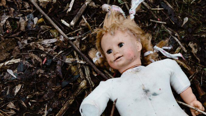 image of battered doll